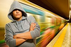 Young criminal in subway Stock Images