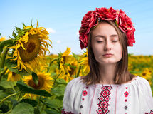 Young crying girl in the Ukrainian national suit Royalty Free Stock Photography