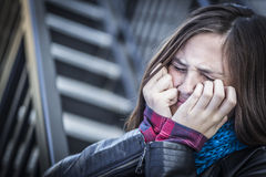 Young Crying Teen Aged Girl on Staircase Stock Photography