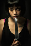 Young crying woman killer. Knife murder suicide. Crazy girl royalty free stock images