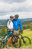 Young cyclists with mountain bikes during summer weekend Royalty Free Stock Photos