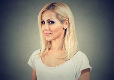 Young curious blond woman looking at camera royalty free stock photography