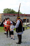 Young, curious boy learning how to fire a musket,Fort William Henry,Lake George,New York,2016 Stock Image