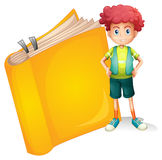 A young curly boy and a big book Royalty Free Stock Image