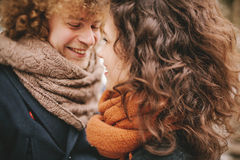 Young curly couple smiling at each other Royalty Free Stock Image