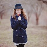 Young curly hair woman in spring garden Royalty Free Stock Images