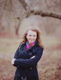 Young curly hair woman in spring garden Stock Photography