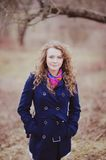 Young curly hair woman in spring garden Royalty Free Stock Photo