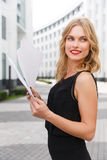 Young curly-headed blond woman with documents Royalty Free Stock Photo