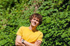 A young curly man in a forest Royalty Free Stock Images