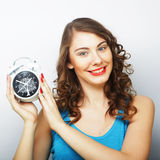 Young curly woman with alarmclock Stock Images