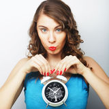 Young curly woman with alarmclock Stock Photos