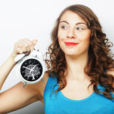 Young curly woman with alarmclock Stock Photography