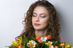 Young curly woman Stock Images