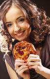 Young curly woman with a cake Royalty Free Stock Image