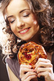Young curly woman with a cake Stock Photography