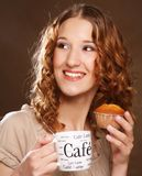 Young woman with coffee and cake Royalty Free Stock Photo