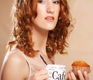 Young woman with coffee and cake Stock Photos