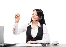 Young custmer support operator writing with a marker Stock Photography