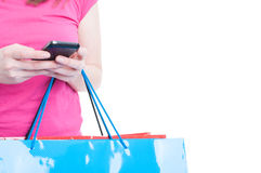 Young customer sending a message on phone in close-up Stock Photo