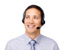 Young customer service agent with headset on. Against a white background Royalty Free Stock Photo