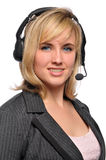 Young customer service representative. Smiling wearing headphones Royalty Free Stock Photography