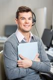 Young Customer Service Representative Holding File Royalty Free Stock Photography