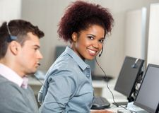 Young Customer Service Representative In Office Royalty Free Stock Photos