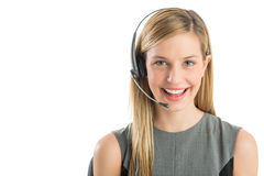 Young Customer Service Representative Wearing Headset. Close-up portrait young female customer service representative wearing headset smiling against white Royalty Free Stock Photos
