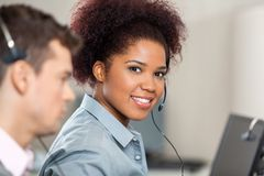 Young Customer Service Representative Working In Royalty Free Stock Images