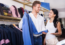 Young customers selecting jacket Stock Photo