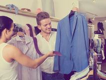 Young customers selecting shirt, jacket and tie Royalty Free Stock Images