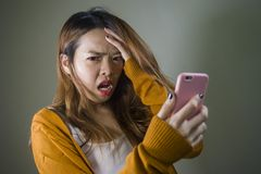 Free Young Cute And Sad Asian Korean Girl Feeling Broken Heart And Desperate Holding Mobile Phone Suffering Relationship Break Up Stock Image - 136142041