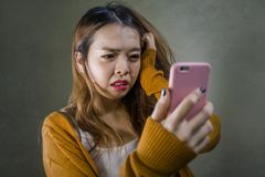 Free Young Cute And Sad Asian Korean Girl Feeling Broken Heart And Desperate Holding Mobile Phone Suffering Relationship Break Up Stock Photography - 136142052