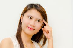 Young cute asian girl thinking Stock Photos