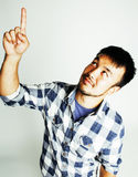 Young cute asian man on white background gesturing emotional, po Royalty Free Stock Image