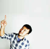 Young cute asian man on white background gesturing emotional, po Royalty Free Stock Images