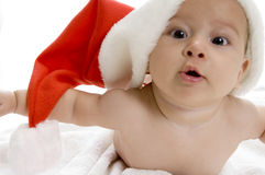 Young cute baby boy with red santa cap Royalty Free Stock Photos