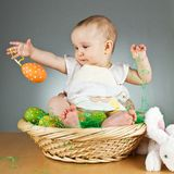 Young cute baby in an easter setting Royalty Free Stock Photo