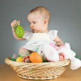 Young cute baby in an easter setting Stock Photo
