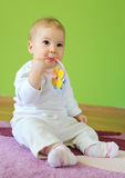 Young cute baby sitting on floor Royalty Free Stock Photo