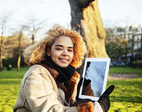 Young cute blond african american girl student holding tablet an Royalty Free Stock Photo