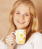 Young cute blond girl drinking coffee close up on Stock Photo