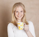 Young cute blond girl drinking coffee close up on Royalty Free Stock Photos