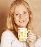 Young cute blond girl drinking coffee close up on Stock Photos