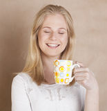 Young cute blond girl drinking coffee close up on Royalty Free Stock Photo