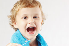 Young cute boy brushing his teeth Stock Photo