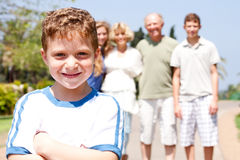 Young cute boy in focus with family Stock Photography