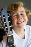 Young cute boy with guitar Royalty Free Stock Photography
