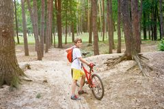 Young cute boy in helmet rides a bicycle in the park. Boy goes on the road. Sport stock photos